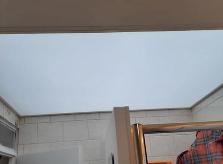 Pose de plafond tendu translucide à Lens